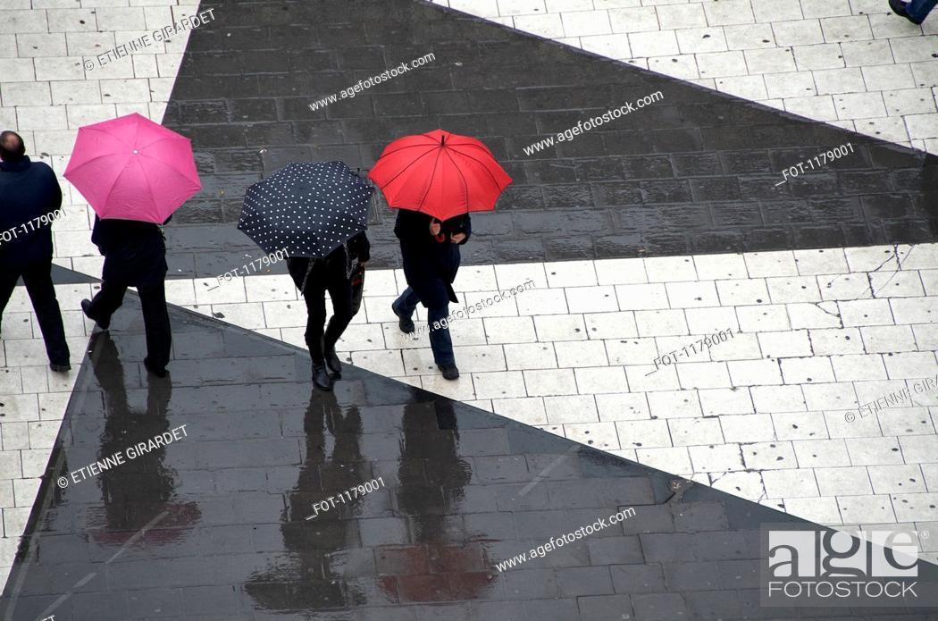 Stock Photo: Pedestrians below with umbrellas.