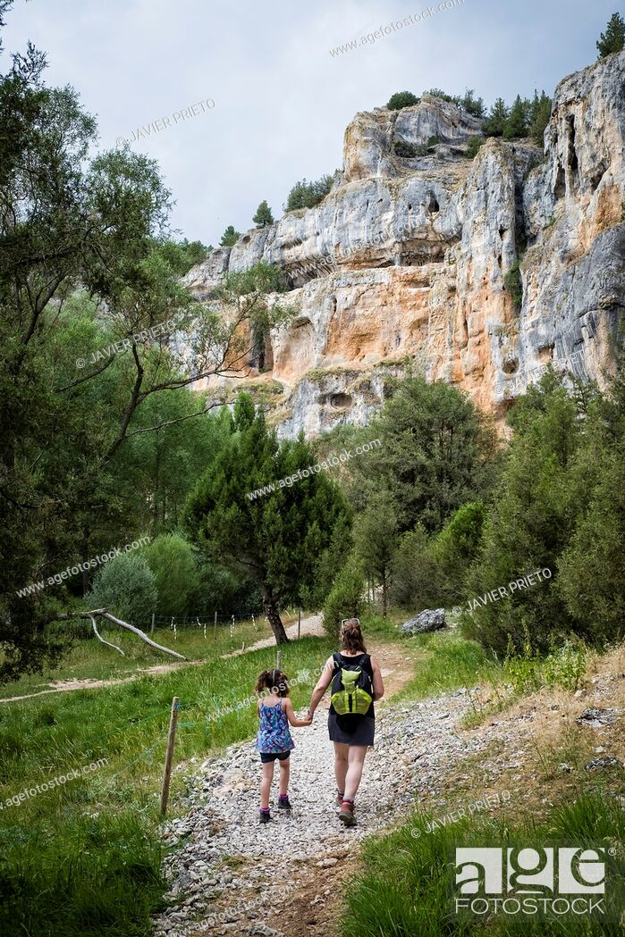 Stock Photo: A five year old woman and a girl five years old walk along the bottom of the Río Lobos Canyon. Rocky Walls in the Canyon Lobos River Natural Park.