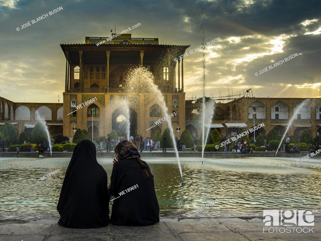 Stock Photo: Naghsh-i Jahan Square, at dusk, when the Isfahan people go out to take the cool.