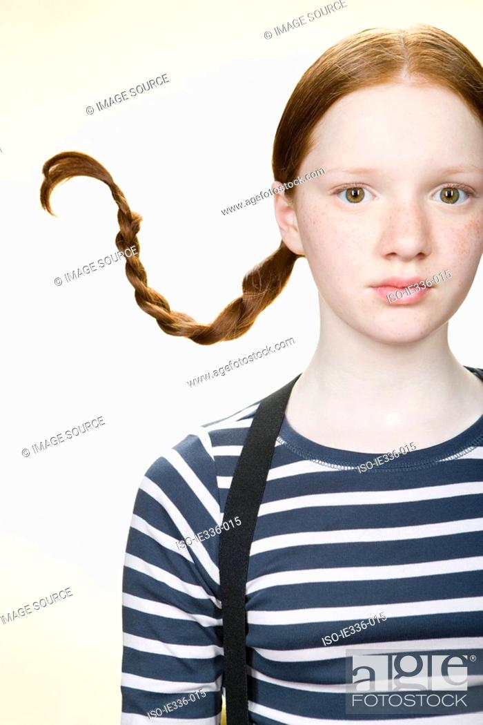 Stock Photo: Portrait of a girl with pigtails.