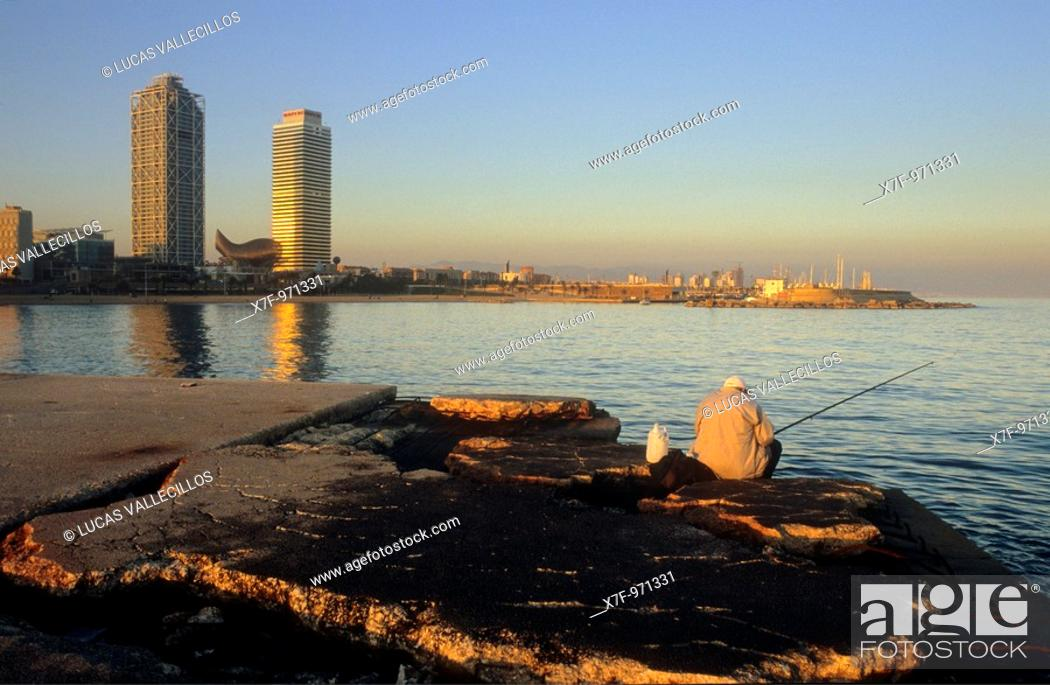 Stock Photo: Barcelona: Fisherman in jetty of Gas Barceloneta beach  In background Mapfre tower and Hotel Arts.