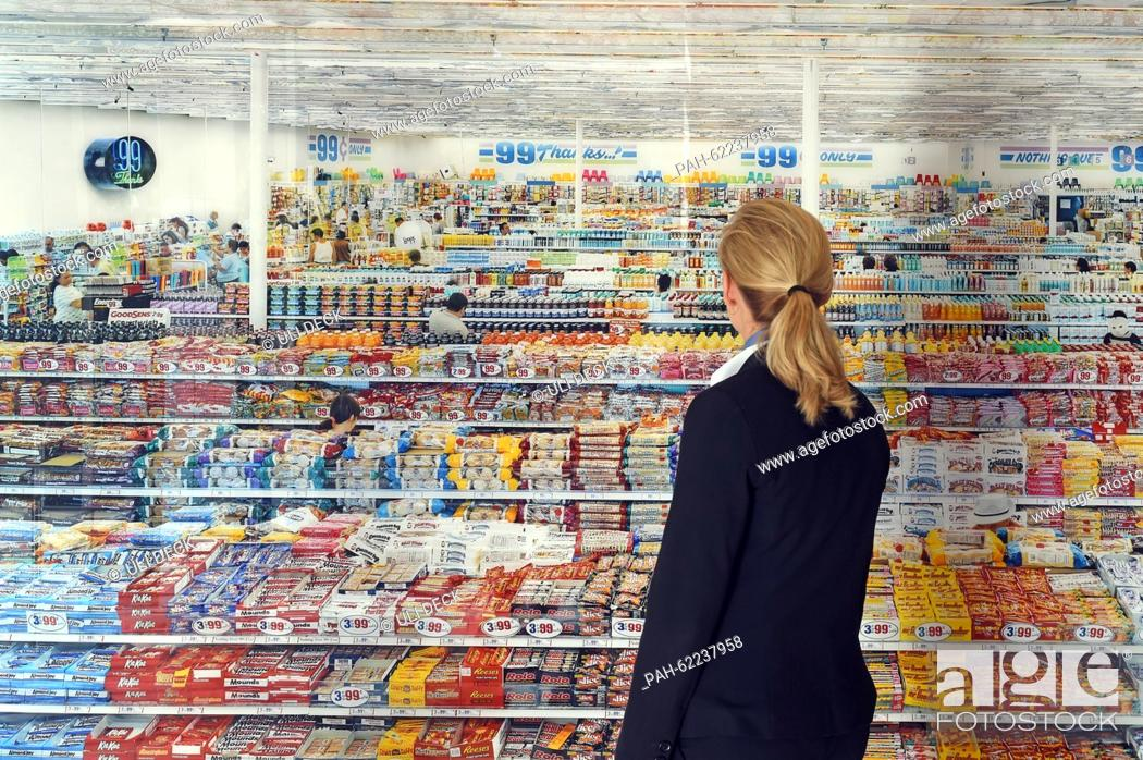 A Woman Looks At The Work 99 Cent 1999 2009 By Artist Andreas