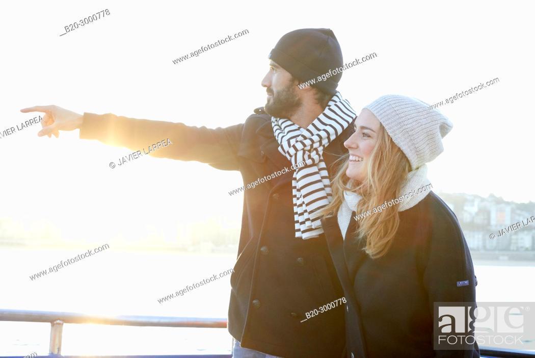 Stock Photo: Couple on a boat trip to Santa Clara Island, La Concha Bay, Donostia, San Sebastian, Gipuzkoa, Basque Country, Spain, Europe, Winter.