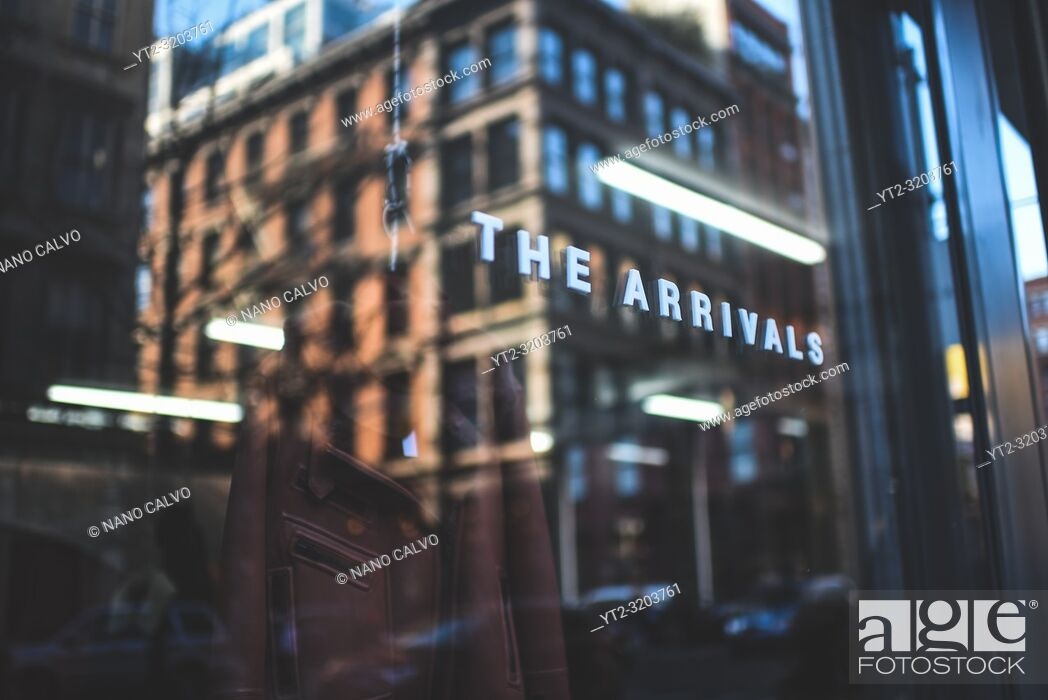 Stock Photo: Reflection on The Arrivals clothes store, SoHo, New York.