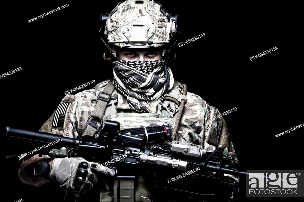 Imagen: US Marine Corps soldier, army special forces fighter, modern combatant in camouflage uniform, battle helmet, tactical radio headset, face hidden behind shemagh.