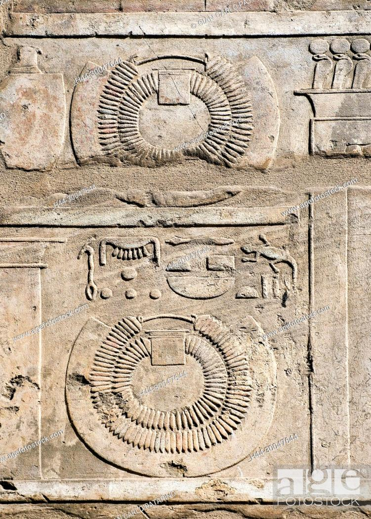 Stock Photo: Karnak, Luxor, Egypt. Temple of Karnak sacred to god Amon: sculptures in a wall showing necklaces.