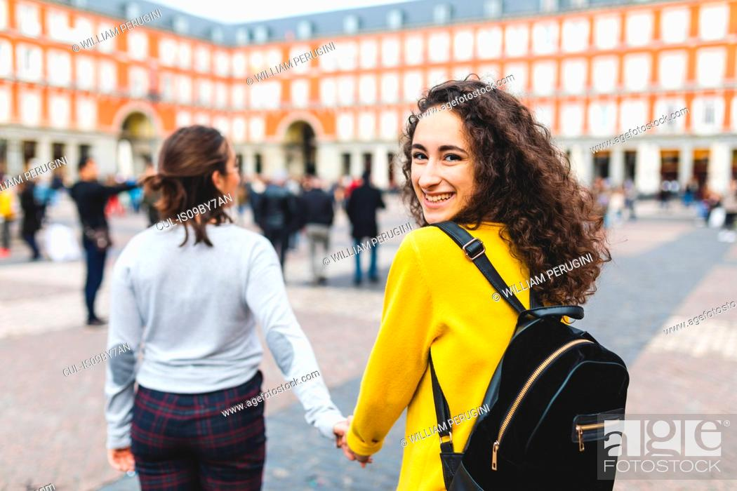 Stock Photo: Girlfriends exploring city, Madrid, Spain.