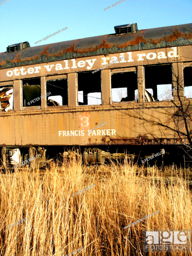 Stock Photo: A decaying railroad car is photographed on a bright November day.