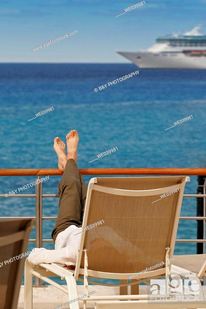 Stock Photo: Woman resting on a deck, Cozumel, Mexico.