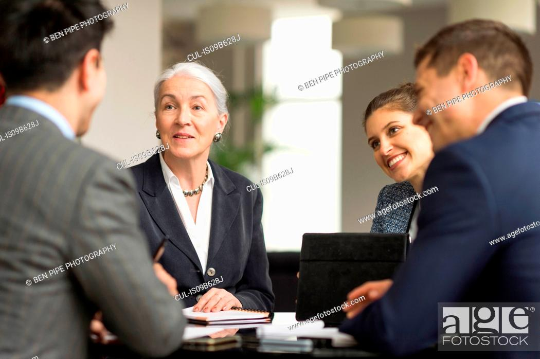 Stock Photo: Over shoulder view of business team meeting in office.