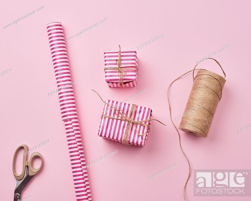 Stock Photo: skein with a brown rope, roll with holiday wrapping paper, scissors and two gifts, top view, DIY crafts.