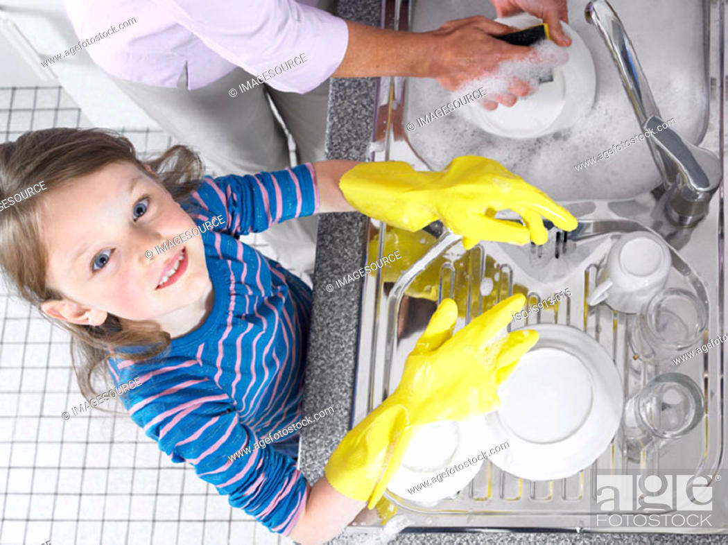 Stock Photo: Girl helping with washing up.