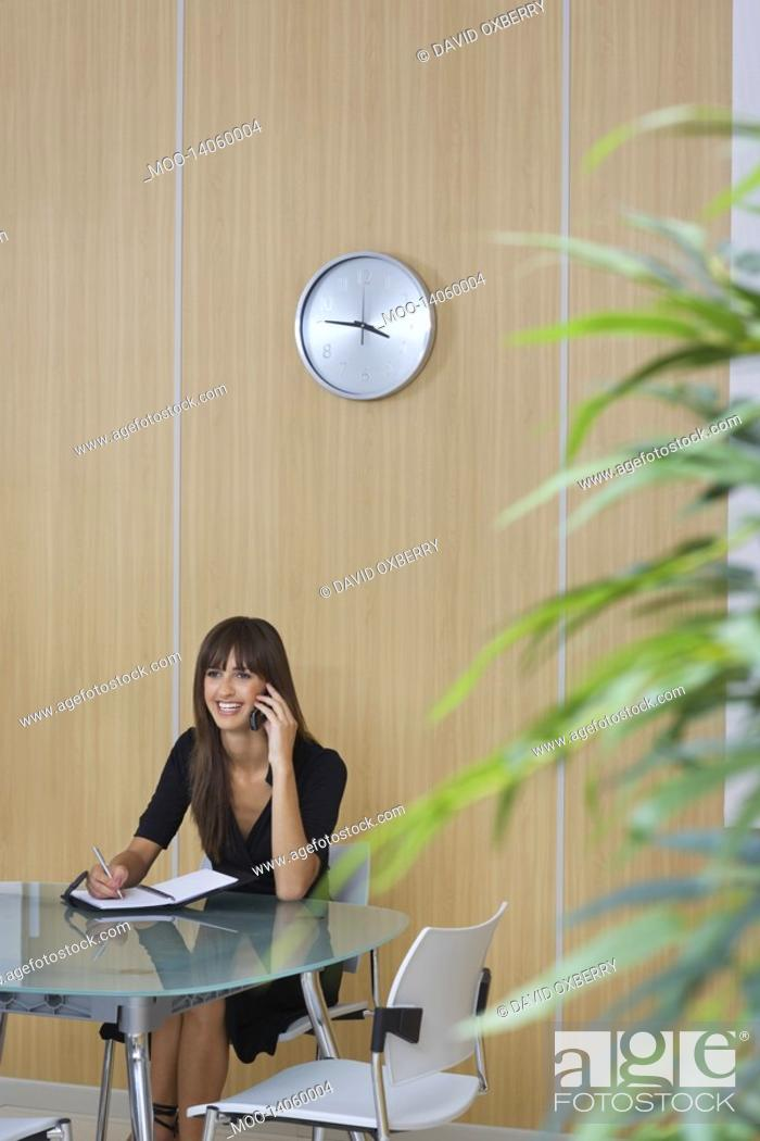 Stock Photo: Business woman using mobile phone in conference room.