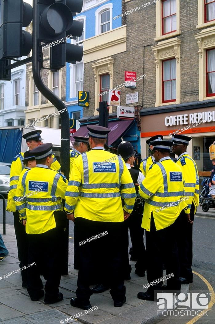 Stock Photo: England - London - Notting Hill district - Metropolitan polices standing by traffic signal.
