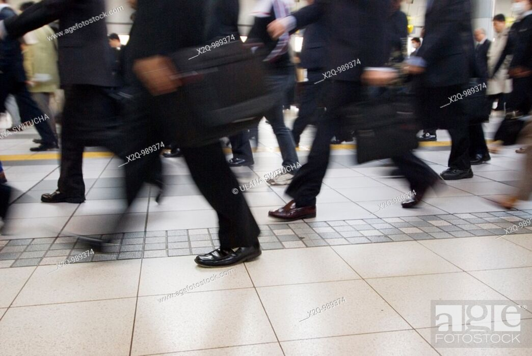 Stock Photo: Rush hour crowds at a train station in Tokyo Japan.