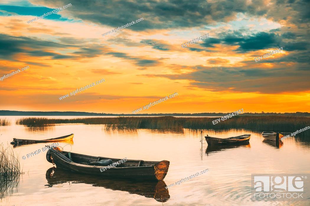 Photo de stock: Braslaw Or Braslau, Vitebsk Voblast, Belarus. Wooden Rowing Fishing Boats In Beautiful Summer Sunset On The Dryvyaty Lake.