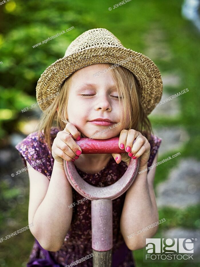 Stock Photo: Smiling girl wearing straw hat.