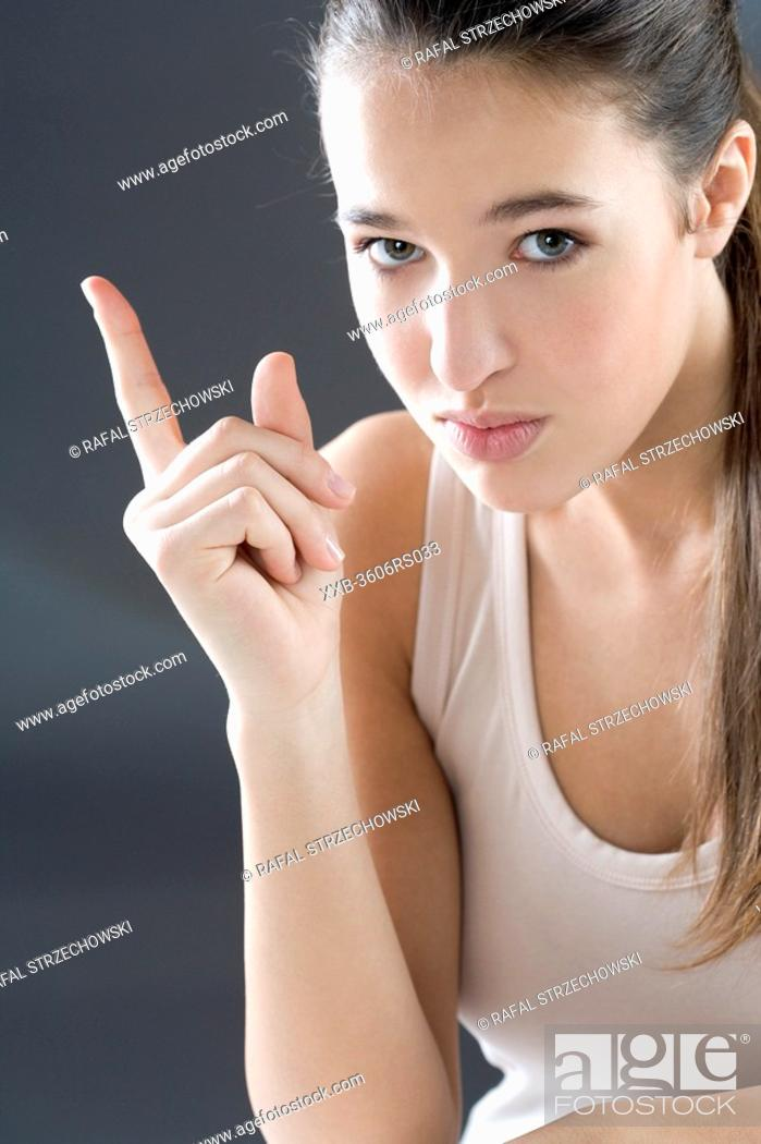 Stock Photo: woman pointing with finger.