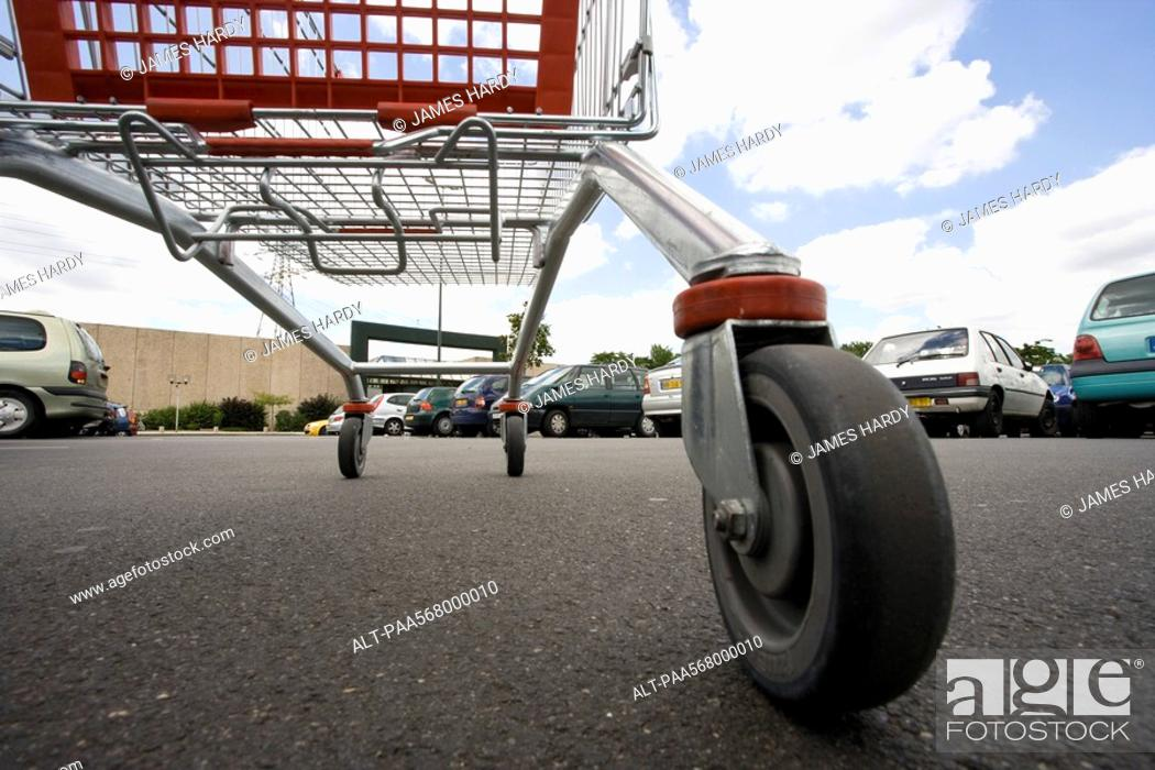 Stock Photo: Shopping cart in parking lot, surface level view.