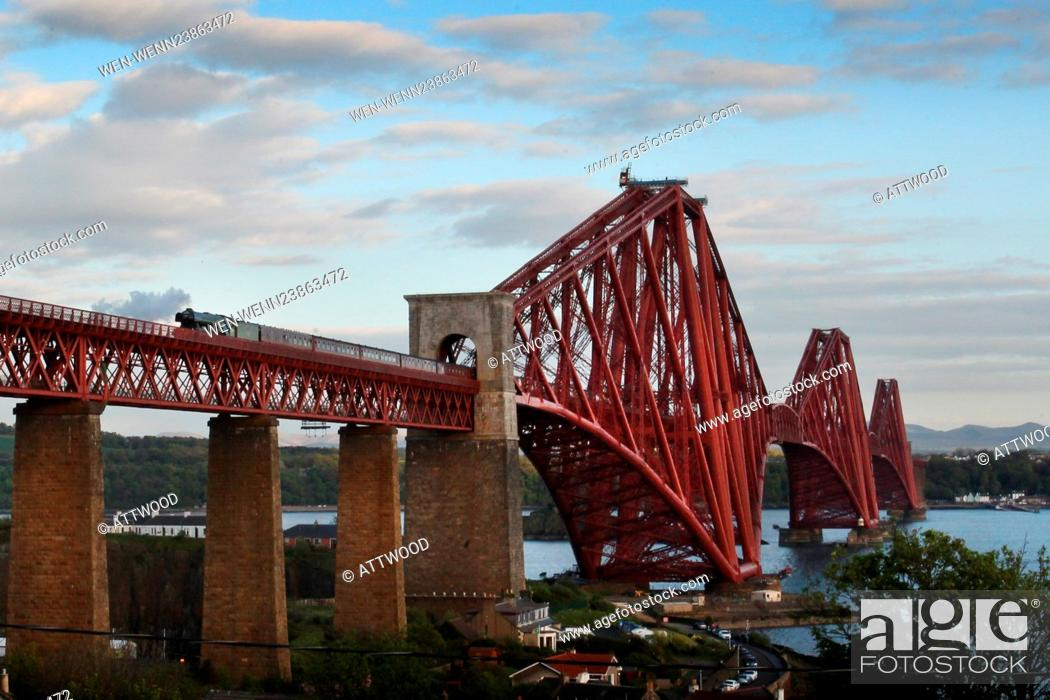 Stock Photo: Steam enthusiasts turn out to watch the Flying Scotsman travel North across the Forth Bridge in North Queensferry, Edinburgh on Sunday evening.