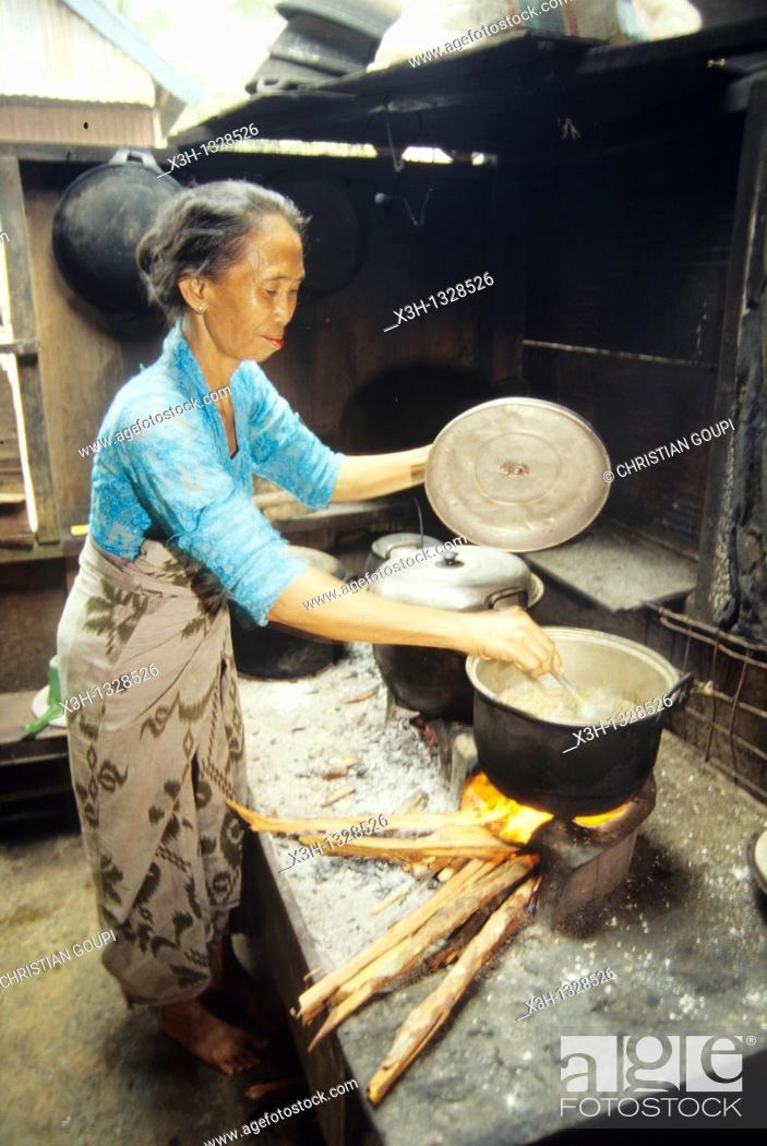 Stock Photo: woman cooking, Sumbawa island, Lesser Sunda Islands, Republic of Indonesia, Southeast Asia and Oceania.