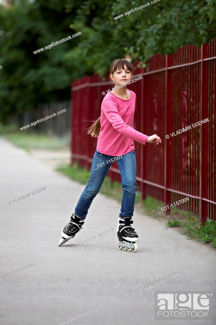 Stock Photo: A girl inline skating.