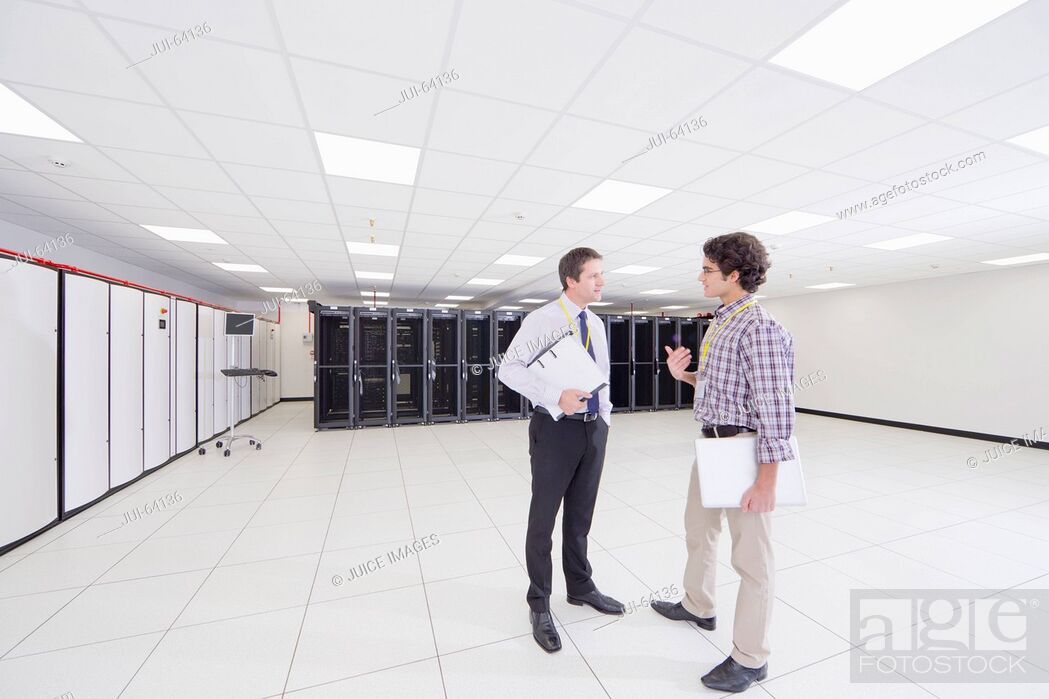 Stock Photo: Manager and technician talking, in server room.