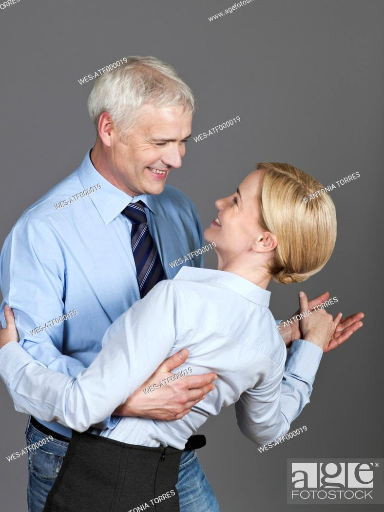 Stock Photo: Mature couple dancing, smiling.