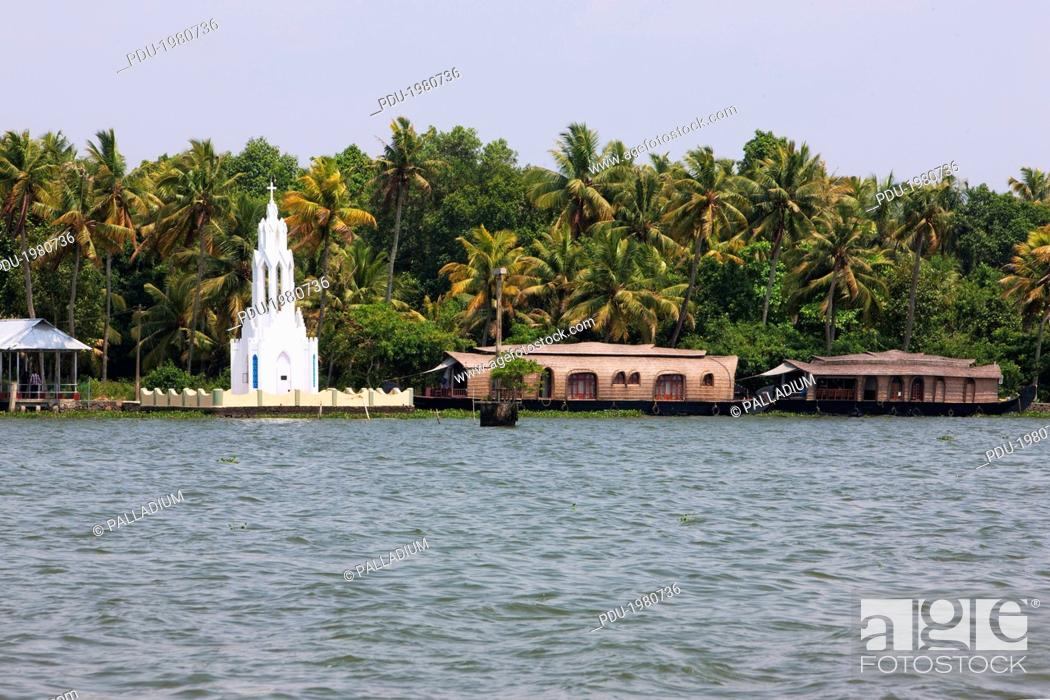 Stock Photo: a shrine and moored rice boats, converted to houseboats for tourists, in the Kerala backwaters.