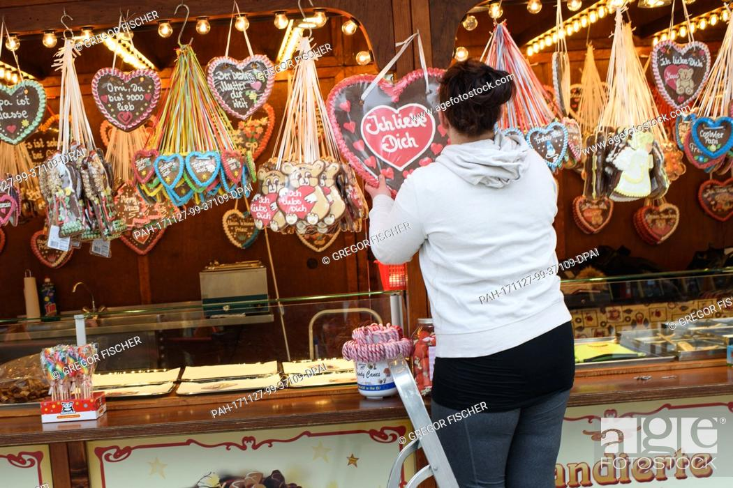 Stock Photo: A stand owner finishes the last preperations before the official opening of the Christmas market at Breitscheidplatz square in Berlin, Germany, 27 November 2017.
