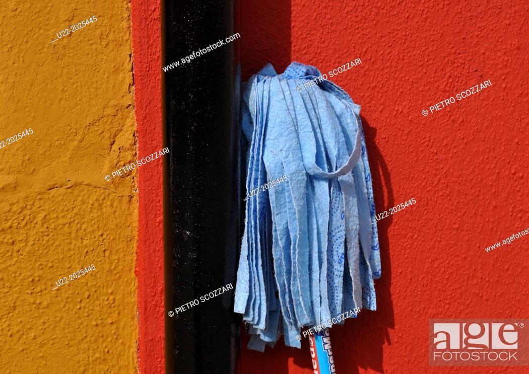 Stock Photo: Burano, Veneto, Italy, broom on a house wall.