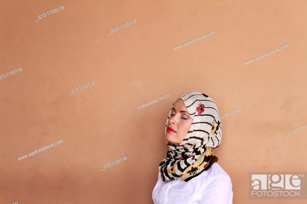 Stock Photo: Young woman wearing a headscarf in Marrakech, Morocco.