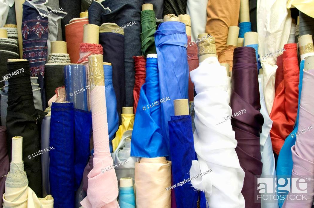Stock Photo: Fabrics in store.
