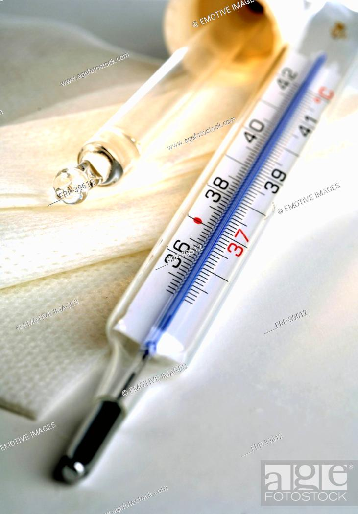 Stock Photo: Clinical thermometer and pipet.