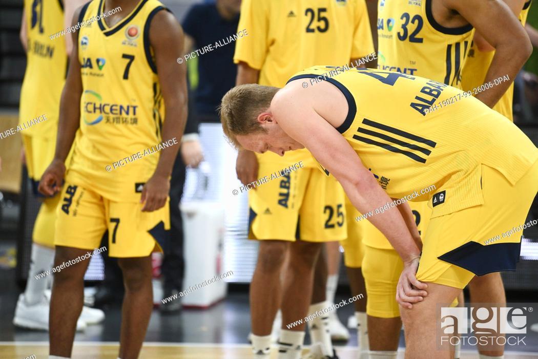 Stock Photo: 17 February 2019, Bavaria, Bamberg: Basketball: BBL Cup, Brose Bamberg - ALBA Berlin, Final: Berlin's Luke Sikma (r) bends forward after defeat.