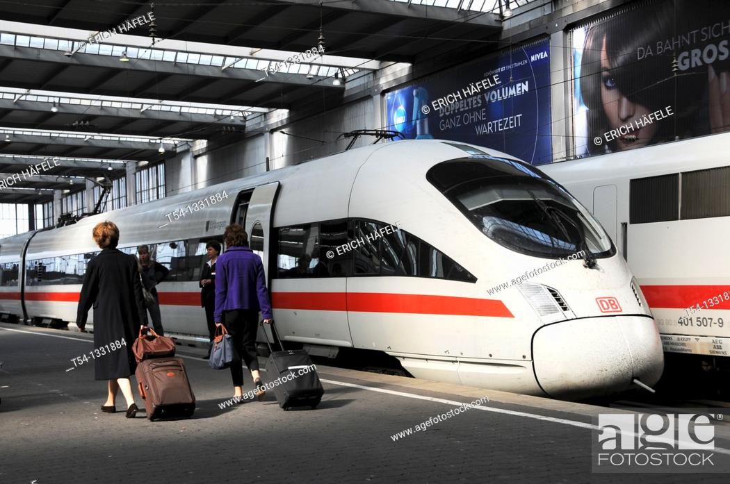 Stock Photo: People walk at the Plattform to a ICE Train in Munich Station.