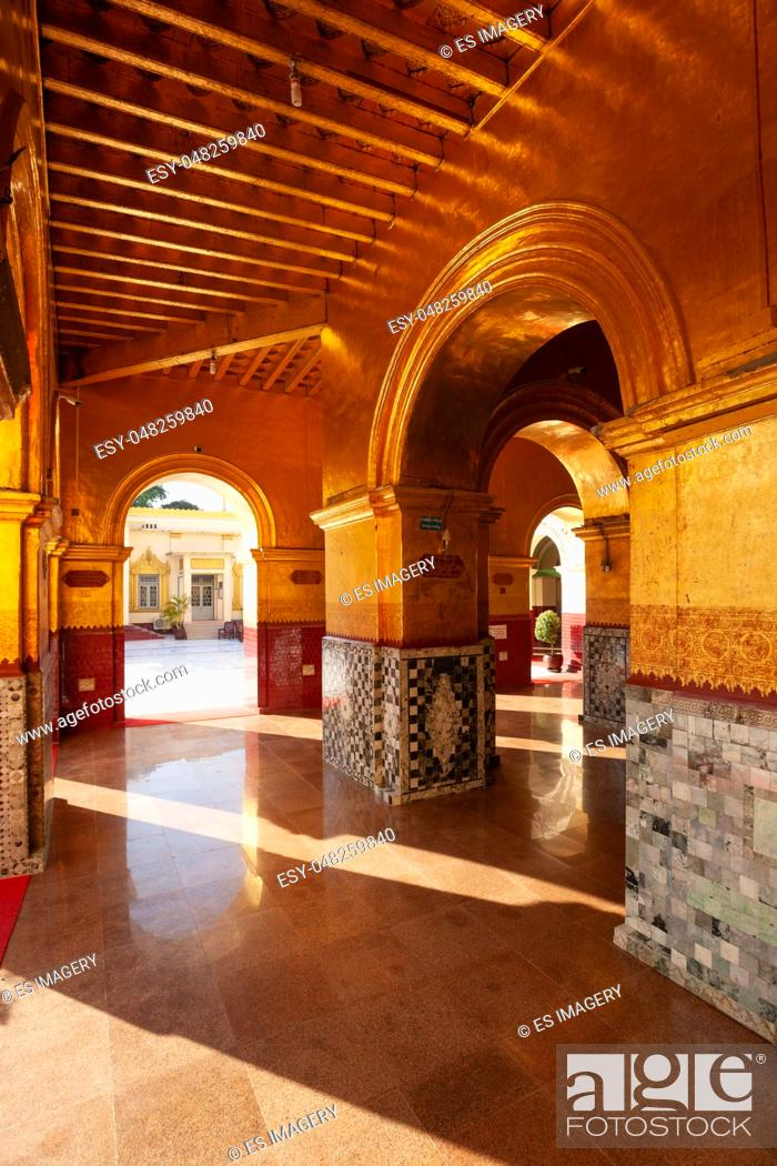 Stock Photo: Golden archways inside the Mahamuni Paya temple at Mandalay, Myanmar.