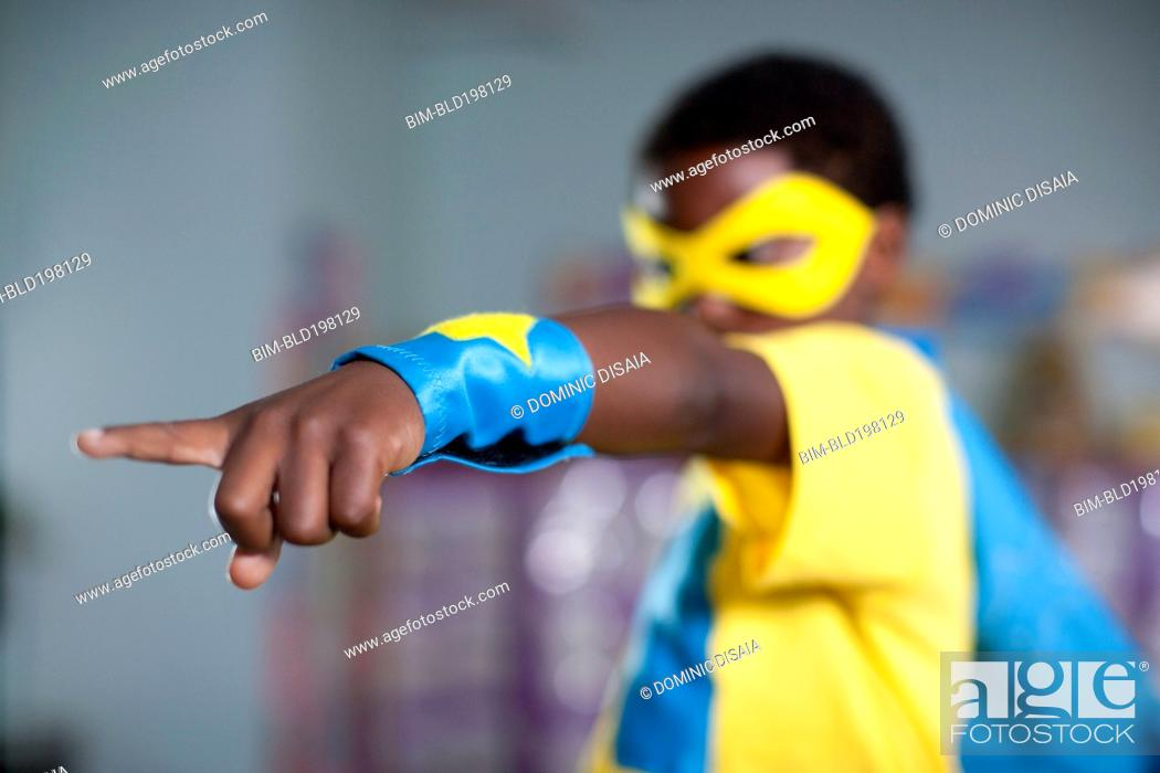 Stock Photo: African American boy playing in superhero costume.