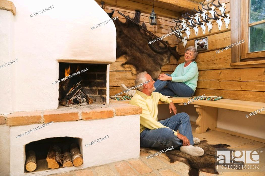 Stock Photo: Senior couple in hunting lodge.