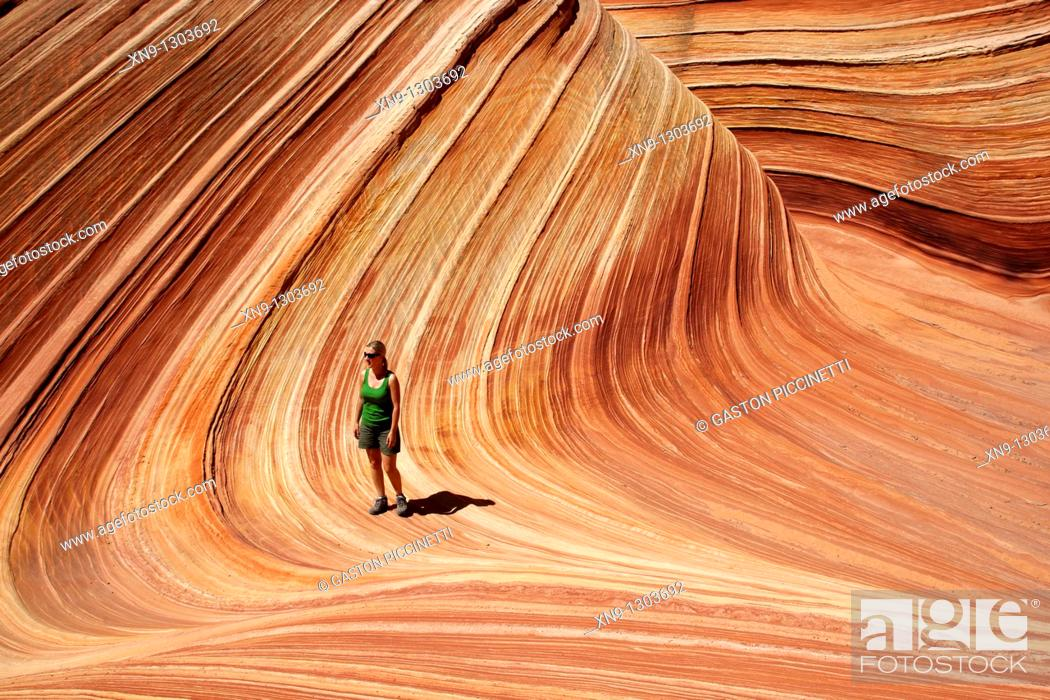 Stock Photo: A woman in the Wave, Vermilion North Coyote Buttes, Paria Canyon-Vermilion Cliffs Wilderness, Vermilion National Monument, Arizona, USA.