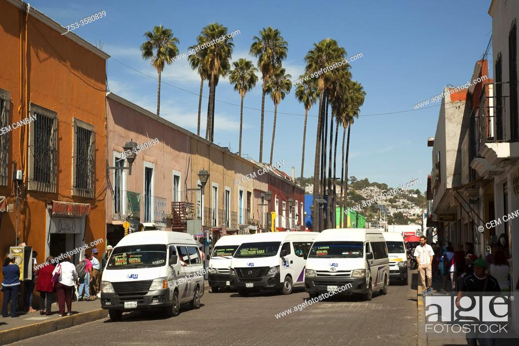 Stock Photo: Street scene with colectivos-shared taxis in the city center of Tlaxcala, Tlaxcala State, Mexico, Central America.