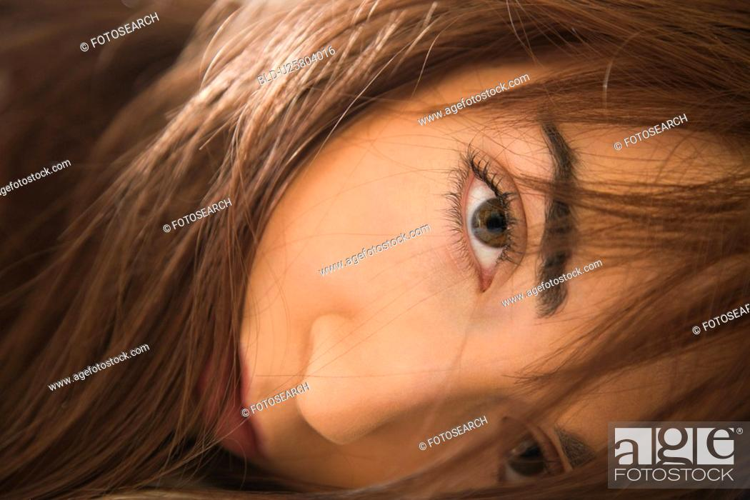 Stock Photo: Close up portrait of woman making eye contact.