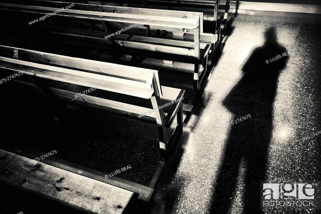 Stock Photo: Photographer's shadow on church floor. Minorca, Balearic Islands, Spain.