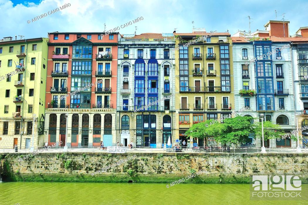 Stock Photo: The riverside of La Ria or the river Nervion in the historical Downtown. Bilbao city, Vizcaya province, Spain.