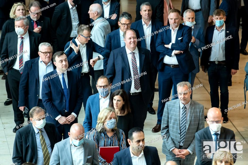 Stock Photo: 03 July 2020, Berlin: Helge Braun (M, CDU), head of the Federal Chancellery, and Paul Ziemiak, CDU Secretary General, stand together with numerous other members.