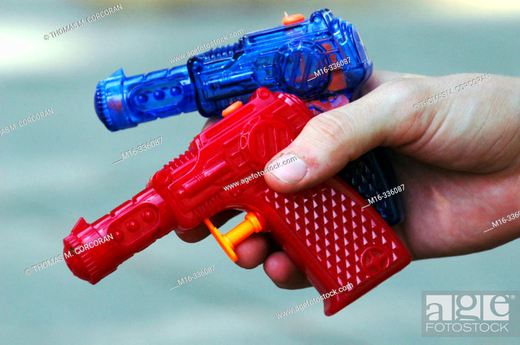 Stock Photo: Two water guns in a hand.