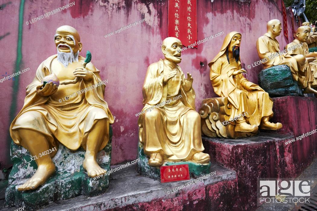 Stock Photo: Statues of arhats (Buddhist equivalent of saints) on the way up to Ten Thousand Buddhas Monastery (Man Fat Sze). Sha Tin, New Territories, Hong Kong.