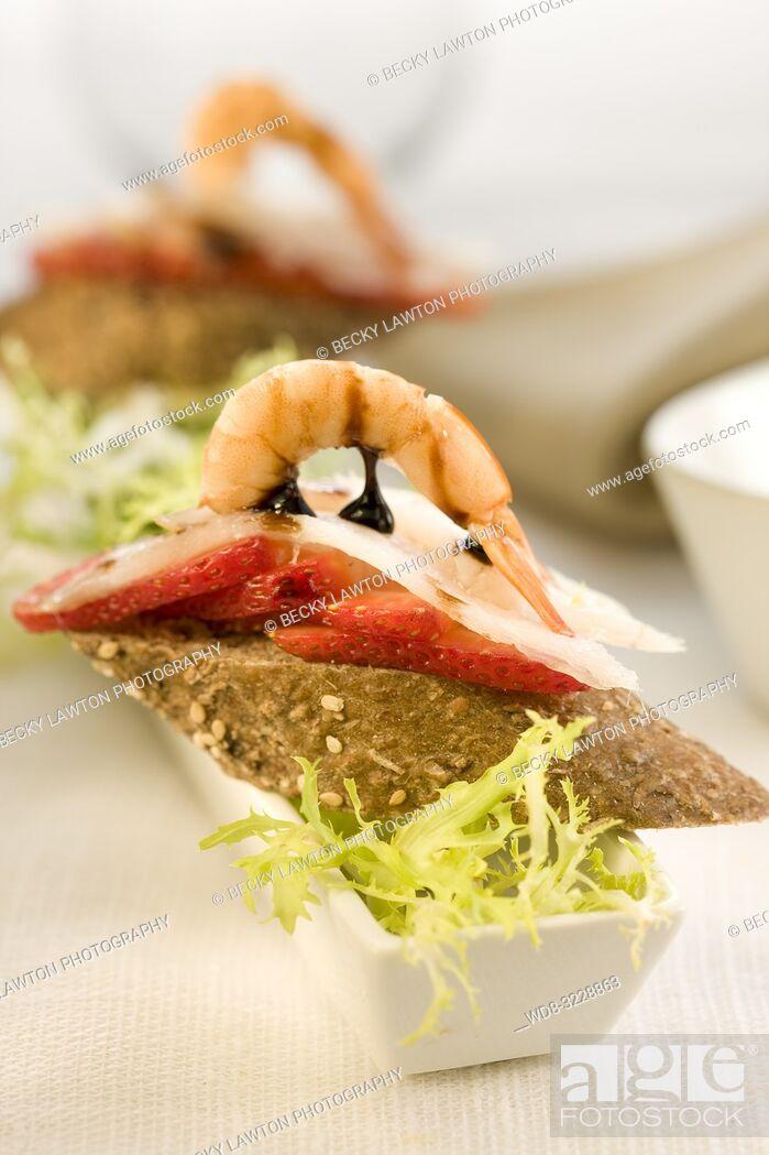 Stock Photo: Montadito de carpaccio de bacalao y fresas.