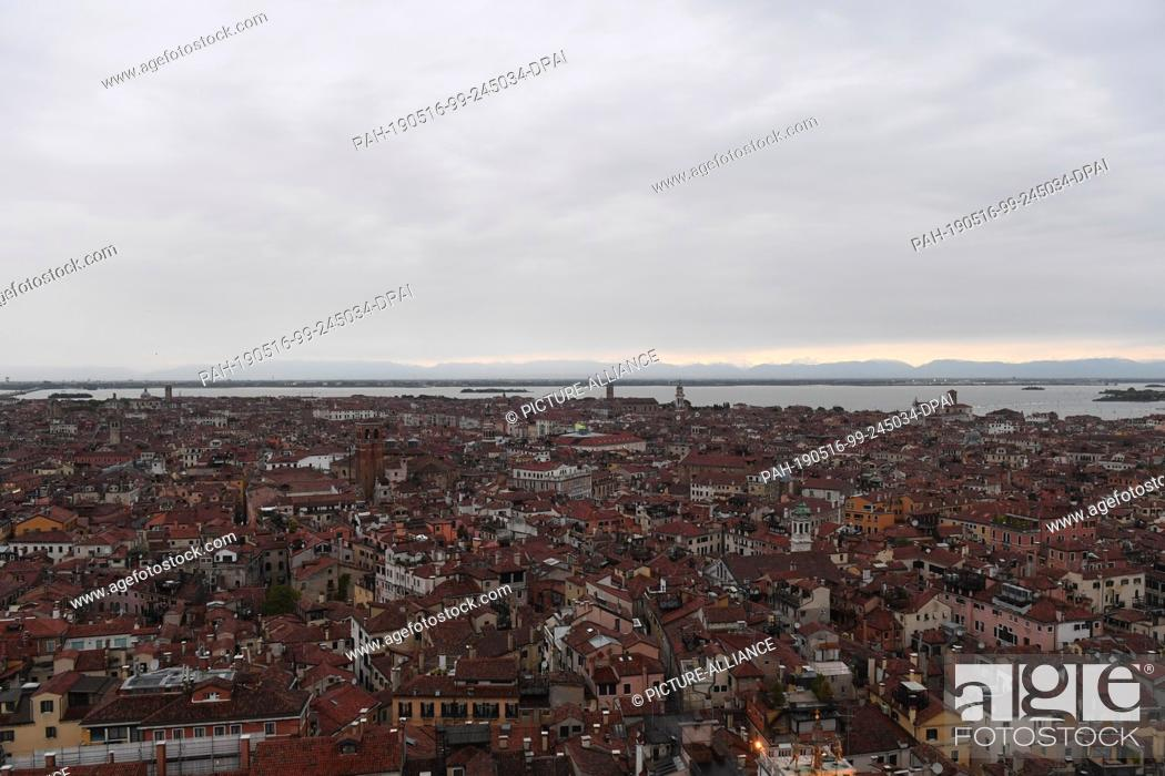 Stock Photo: 12 May 2019, Italy, Venedig: Northern view from Campanile. From the Markusturm clouds lie over the city of Venice. This is where the Art Biennale is currently.