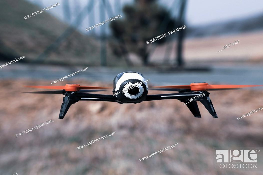 Stock Photo: Flying drone with mounted camera outdoor.